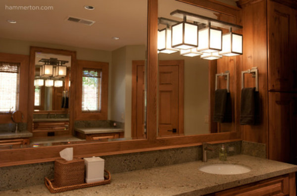 A single fixture with a unique shape can illuminate key sections of the bathroom, including the area above a sink or vanity.