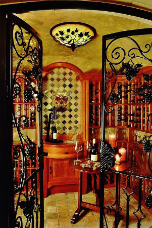 This Mediterranean-inspired wine cellar cleverly incorporates a grape branch motif into a decorative ceiling light.