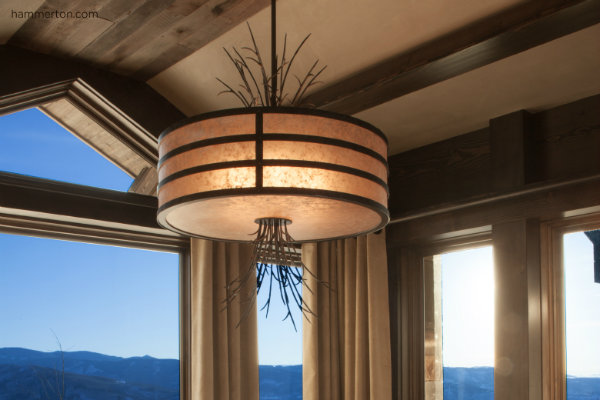 Custom mica drum chandelier accented with delicate organic sprays crafted from steel. This design detail expands the scale of the drum fixture to suit the space without adding any visual weight.