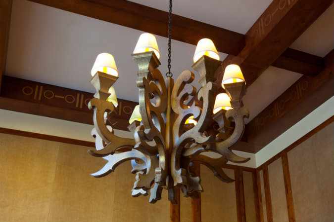 This ornate chandelier, custom designed by Hammerton for the Ritz-Carlton Residences in Vail, Colorado, is a good example of incorporating wood to extend an organic aesthetic to a traditional design.