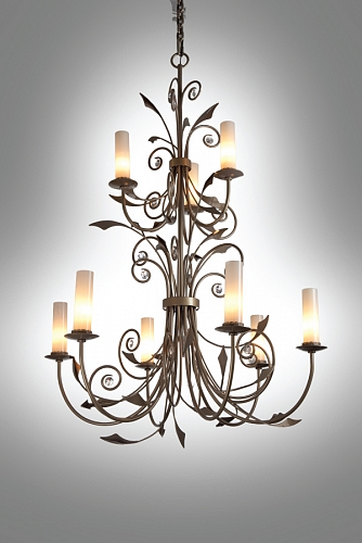 The Hammerton Chateau chandelier CH9238 incorporates a subtle organic feel to a traditional European chandelier form. Shown here with light art glass cylinders, decorative banding and an antique bronze finish.