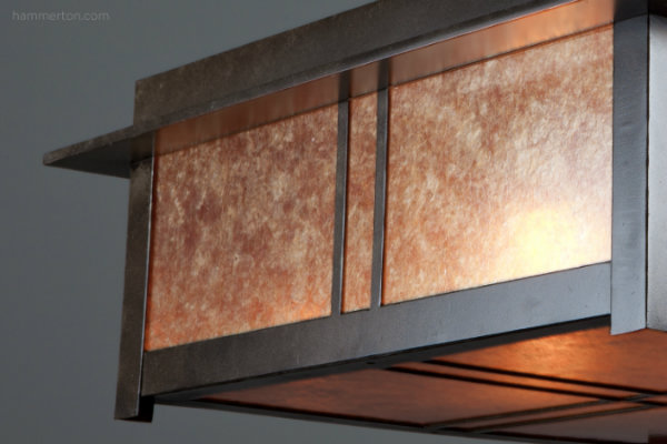 This custom Craftsman ceiling light with dark mica and a premium dark bronze finish diffuses a warm and inviting glow.