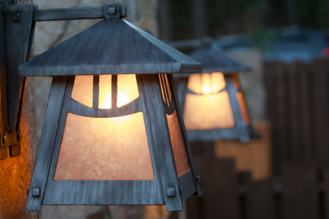 This Craftsman outdoor sconce with dark mica and an antique finish is crafted to withstand the elements for years to come.