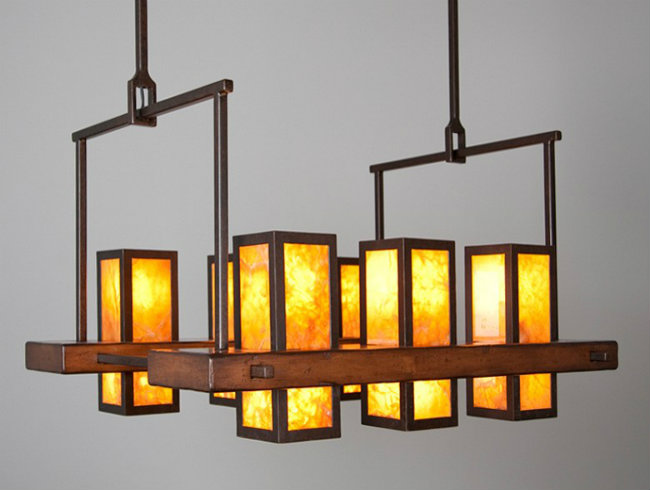 This custom chandelier features hand-hewn panels of honey onyx stone that create both visual interest and a wonderfully warm atmosphere in any space.