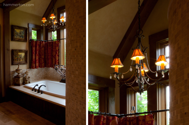 An elaborate fixture with traditional shades and beaded details is an unexpected way to add style to this master bath.