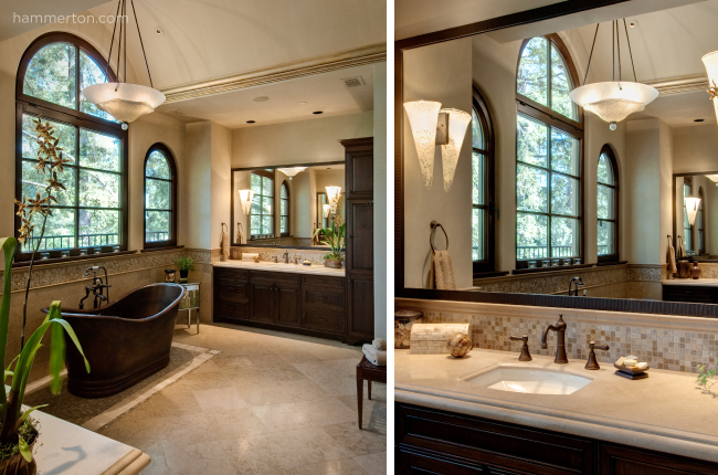 A blown glass bowl pendant adds artistic detail and commands focus on the beautiful tub in this master bath.
