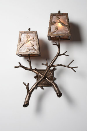 This rustic chic sconce design features crossing branches with natural textures and a polished look, perfect for traditional and transitional designs.