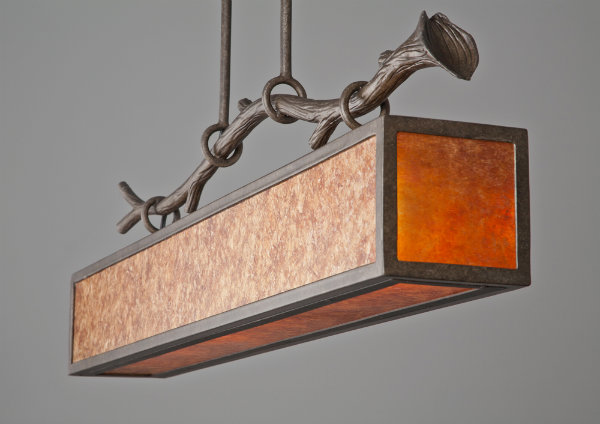 This pool light features an organic branch with graceful curves that define the look as both rustic and unconventionally contemporary.