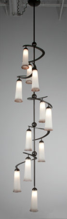 Reminiscent of the majestic foxglove flower, this Lightspann Cascade chandelier features a striking aesthetic with its sculptural silhouette and creamy, lip-tinted blown glass shades.