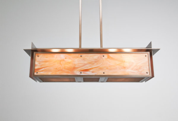 This pool light design is an artistic interpretation of some of the most basic concepts idealized by Frank Lloyd Wright. Stark lines and junctions are modernized by unexpected, contemporary materials, including polished metal and blown glass to achieve an unusual statement piece.