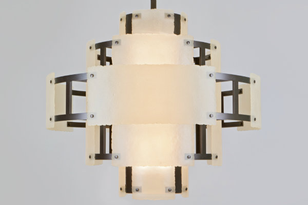 Fused textured crystal glass and smooth steel are brilliantly combined in this boldly tiered contemporary-style custom chandelier.