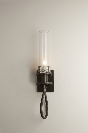 This industrial-chic custom wall sconce flaunts a textured metal base and a bold cord finished in matte black.