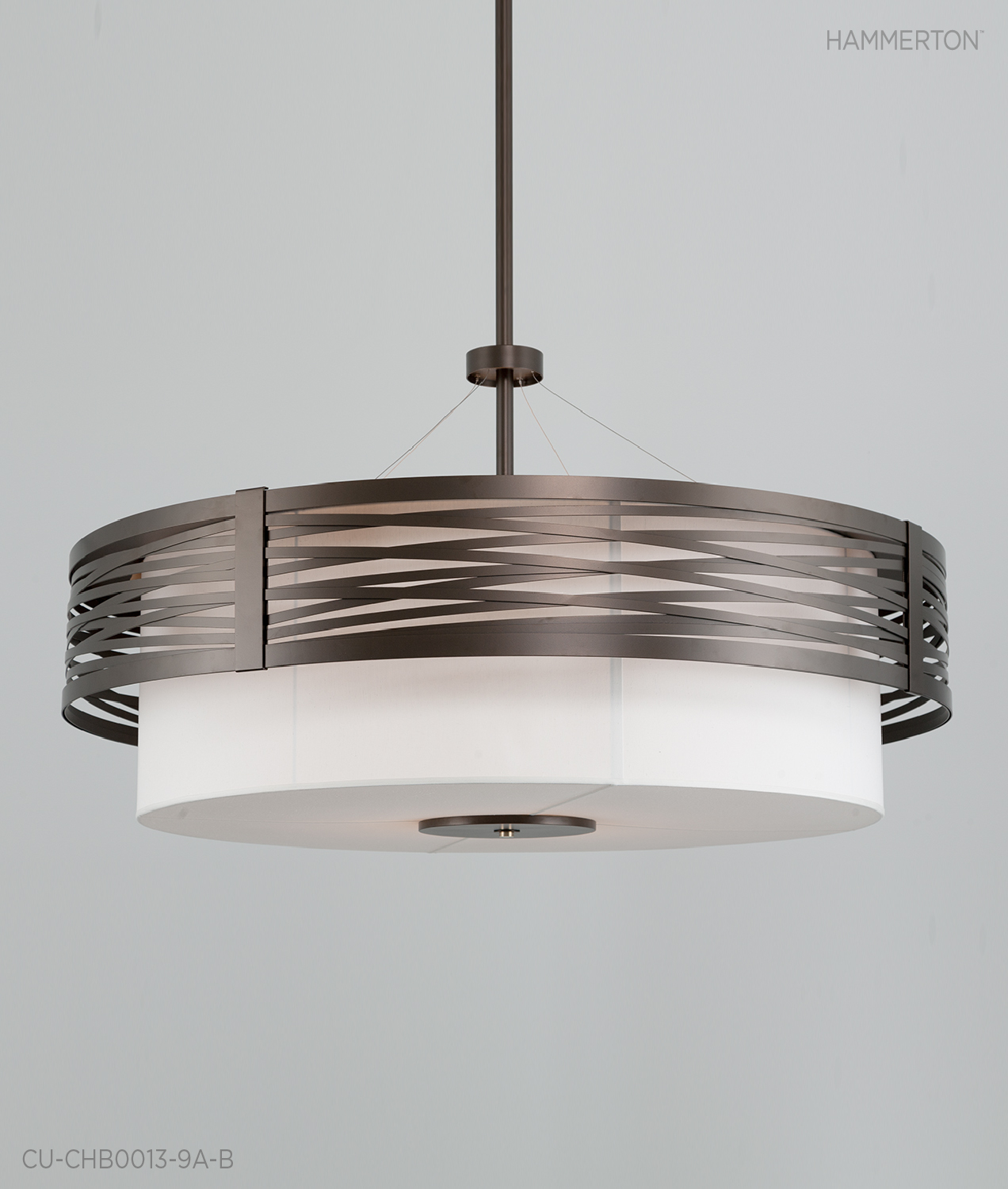 An enormous 6 ft dia custom Tempest chandelier with Flat Bronze Metallic finish. The custom fabric shade in Regal Ivory provides a soft contrast against the metal work.  Fixture: CU-CHB0013-9A-B