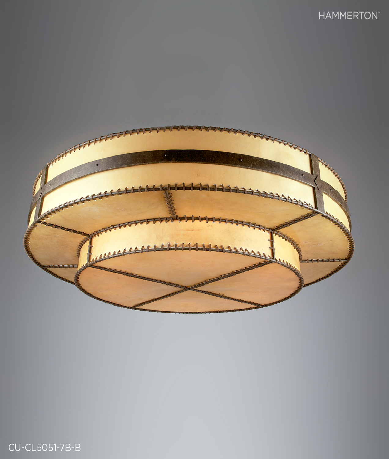 A striking 5 ft dia Rawhide custom Log and Timber ceiling light with leather lashing in an Antique Bronze finish.  Fixture: CU-CL5051-7B-B