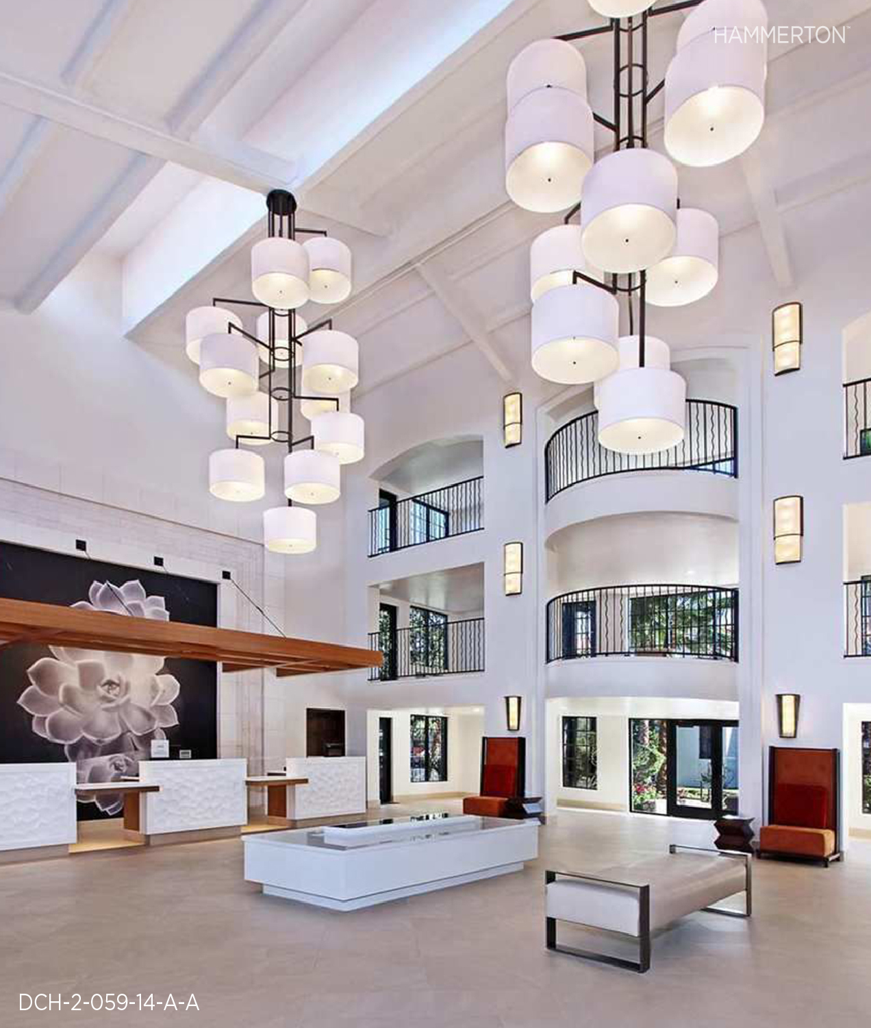 Two spectacular 14 ft tall contemporary chandeliers hang in the E  mbassy Suites, Palm Desert grand foyer. Laura White Linen shades are grouped in cloud like formations, each with Frosted Acrylic bottom diffusers. A rich Matte Black Metallic finish provides a striking contrast against the pale white of the shades and walls. Interiors by Level 3 Design Group.    Fixture: DCH-2-059-14A-A