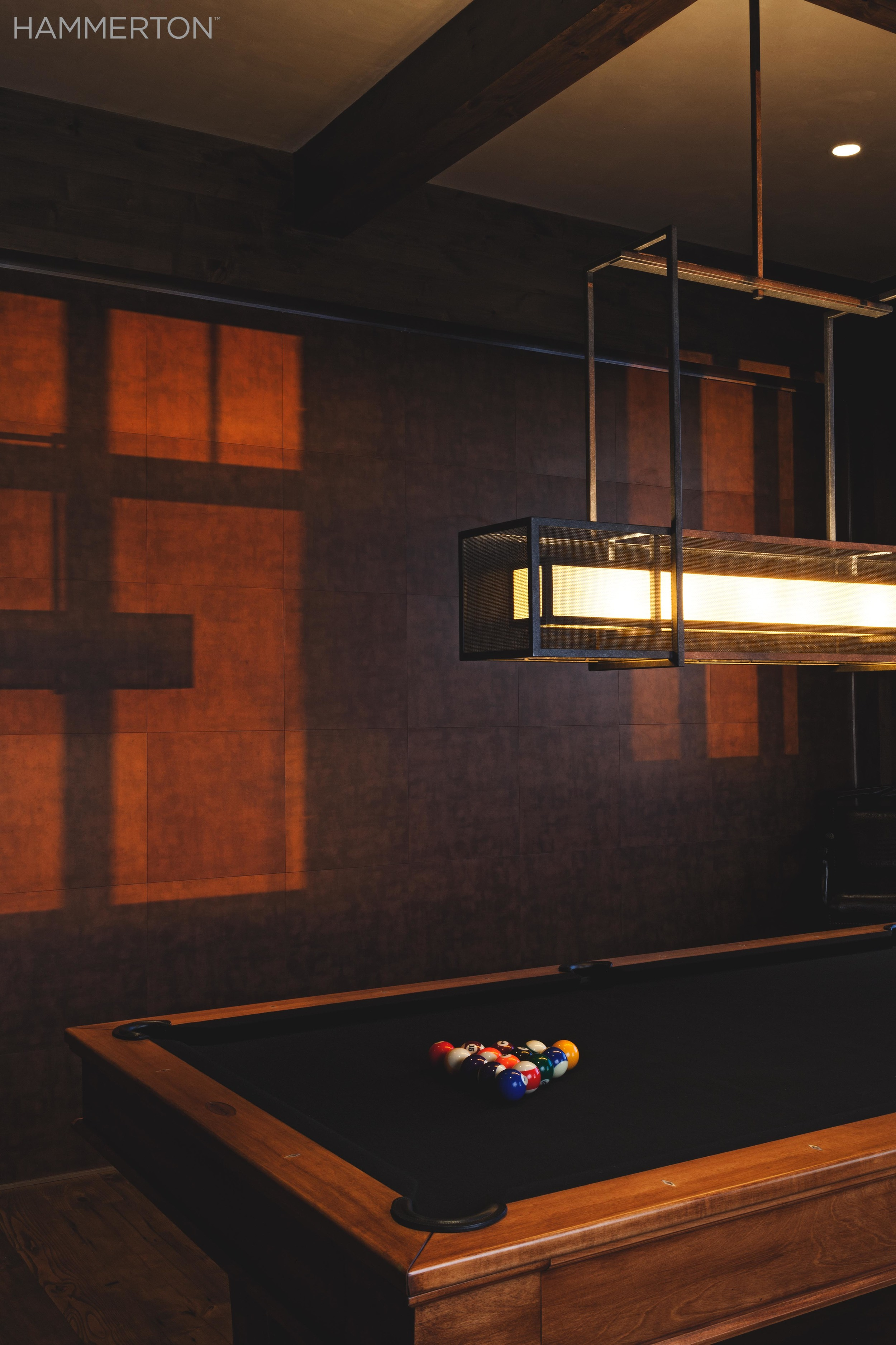 Our most popular pool/dining light, the PL2150, sits above a pool table with rich orange wood tones.