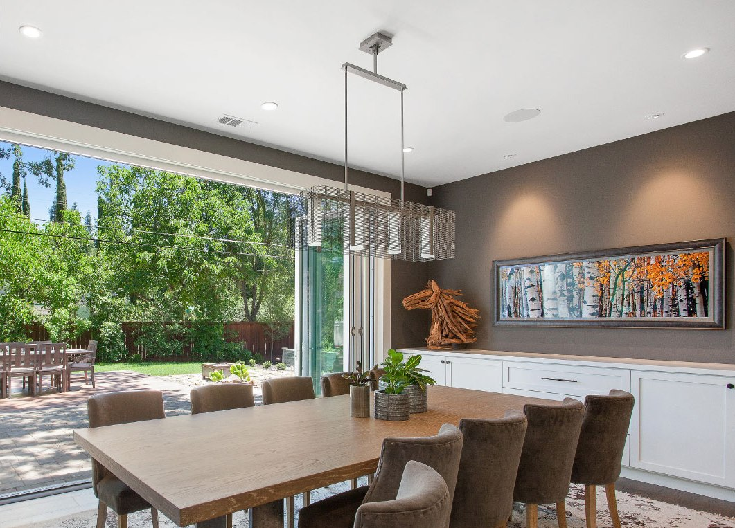 Another LMK project with a breezy dining area open to the outdoors. A Downtown Mesh linear suspension floats above the table.
