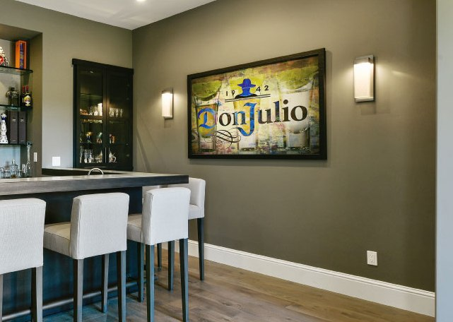 An LMK client opted to switch out a dining area for this festive Tequila bar. On the wall: Parallel LED sconces.