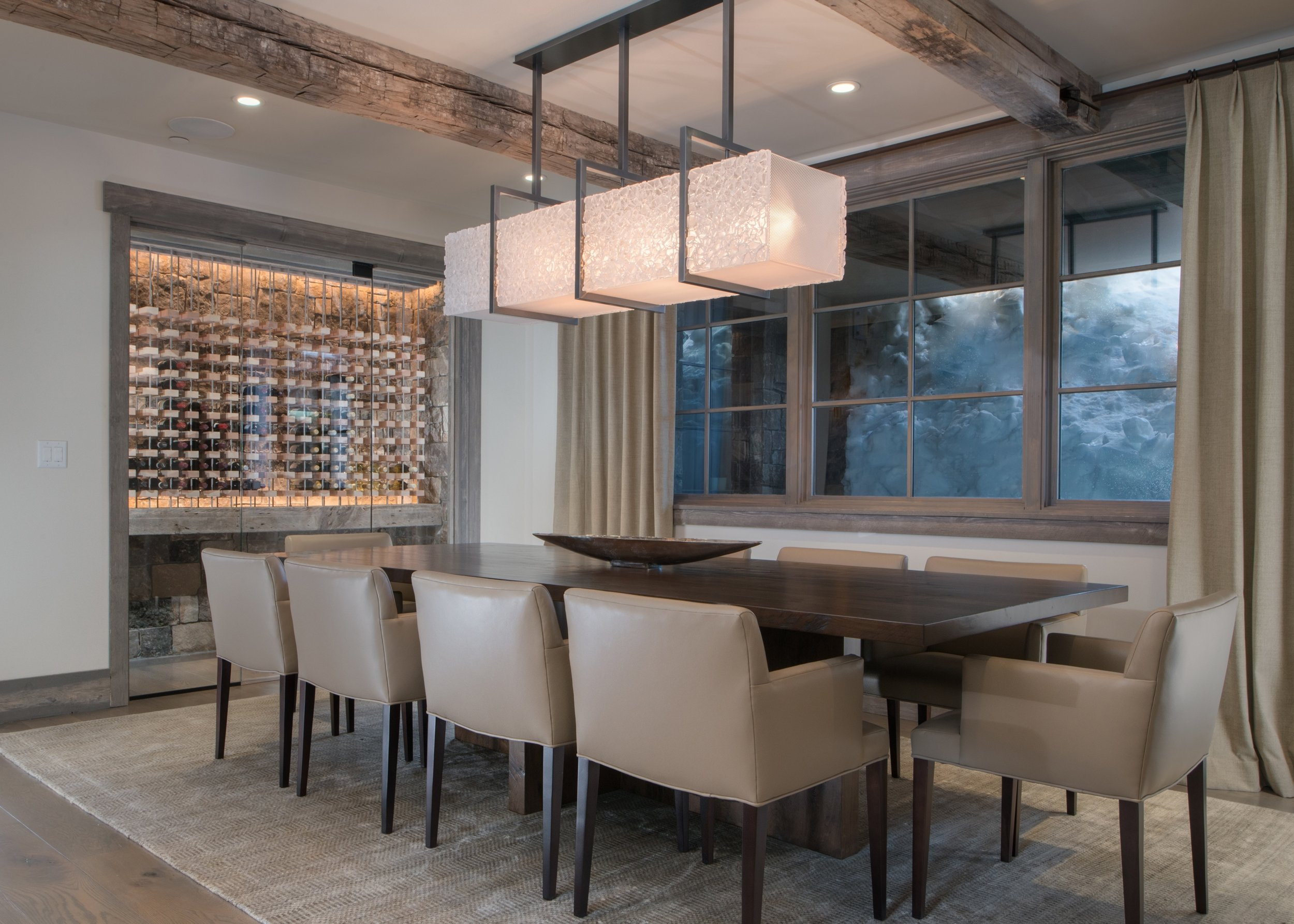 A glistening custom Hammerton dining light in artisan fused glass hangs in the dining room of this contemporary mountain home by   KAM Designs . See this entire project  in our  Shooting Star residential case study >