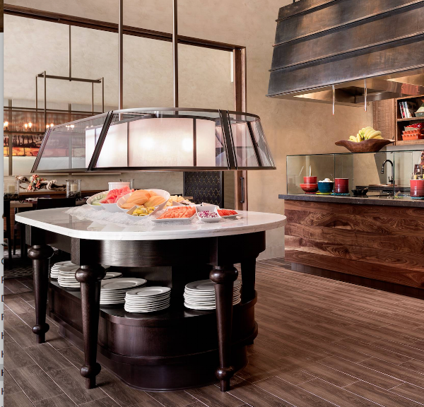 A buffet bar light that doubles as a retractable sneeze guard, designed and built for the Watertable Restaurant at the Hyatt Regency in Huntington Beach, CA. Interiors by EDG Interior Architecture and Design.