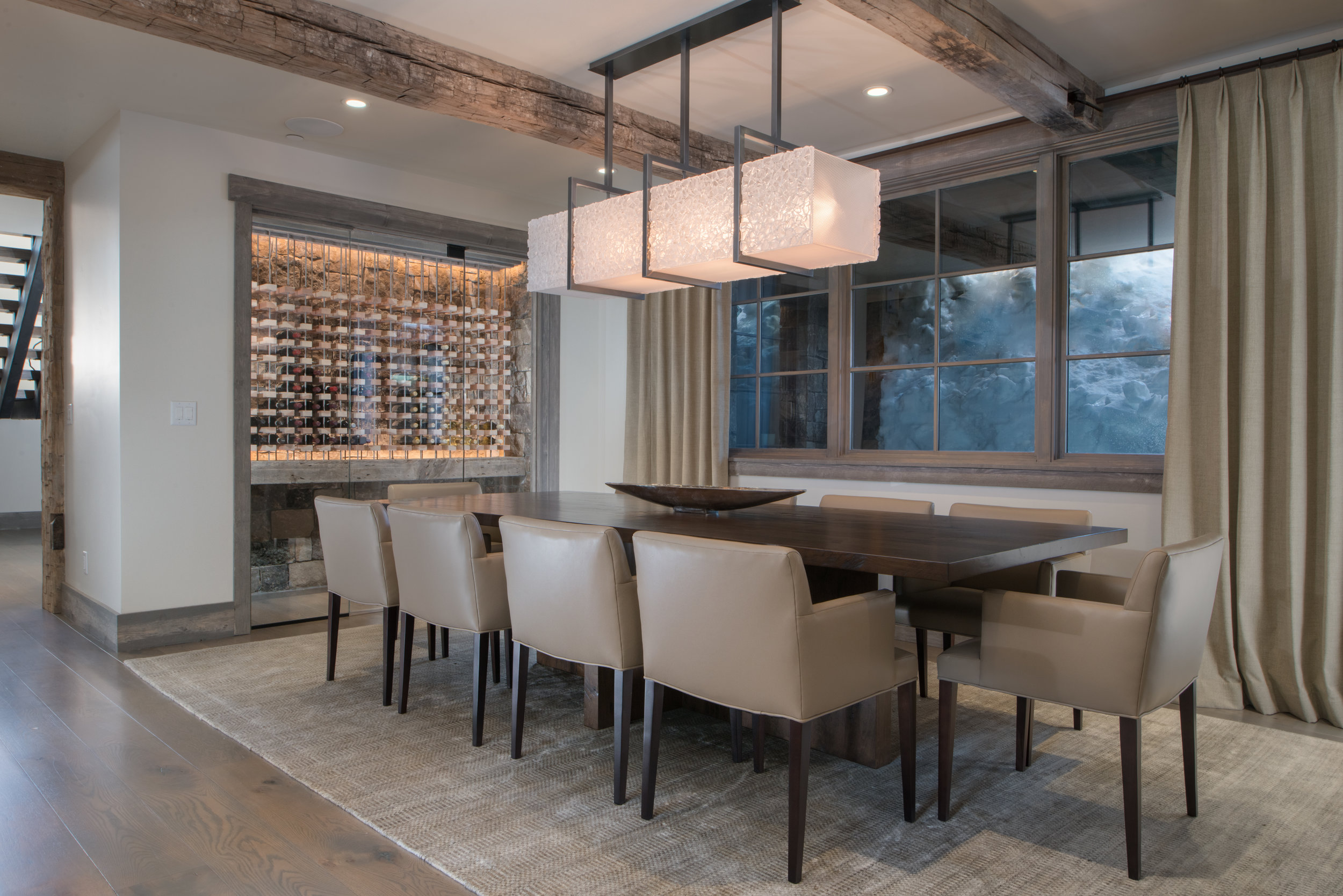 A custom Hammerton linear suspension featuring glistening panels of hand-textured kiln-fused glass. Interior by KAM Designs l Danville, CA