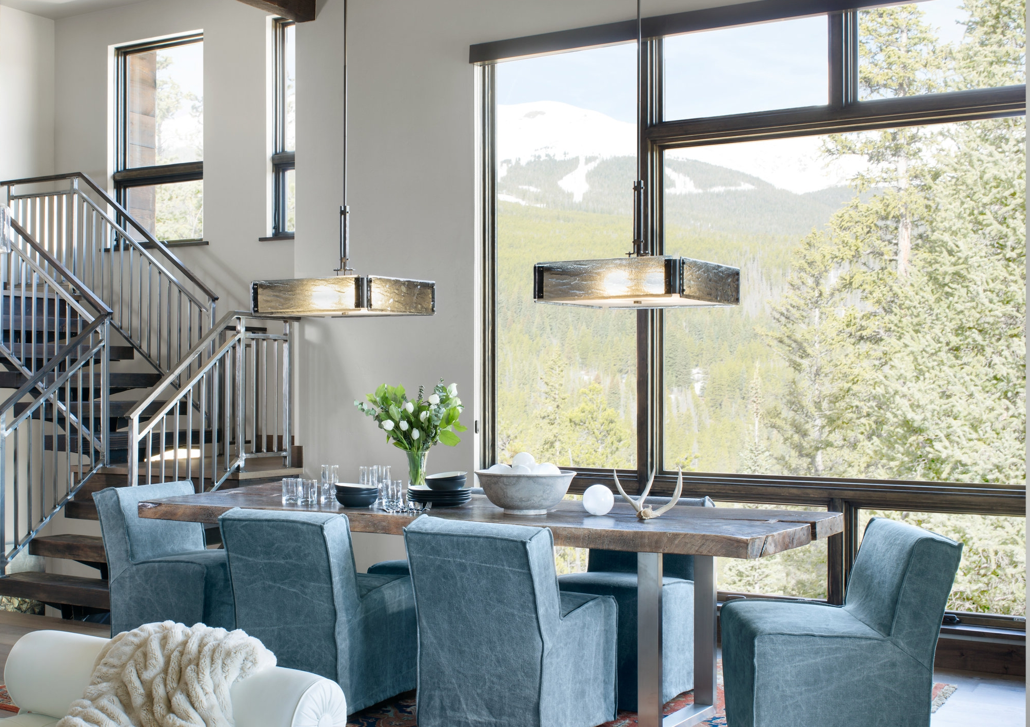Two Hammerton Studio Urban Loft square chandeliers over a rustic contemporary mountain dining table. By PInnacle Design Studio | Frisco, CO