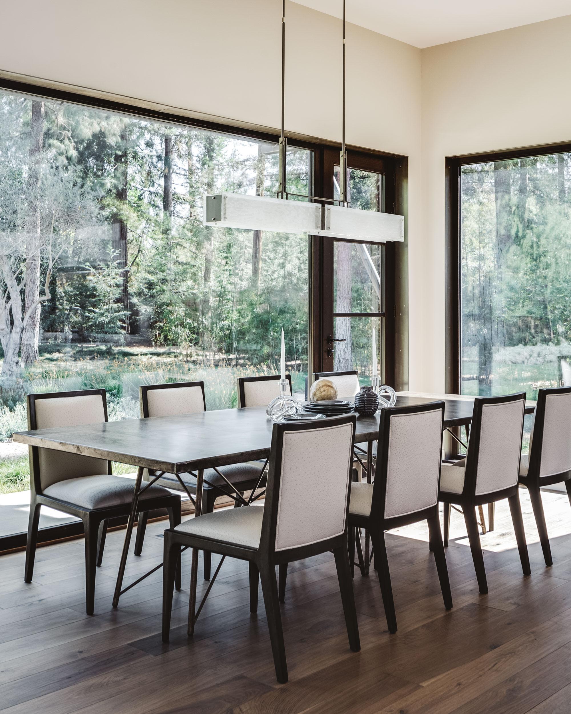 A Hammerton Studio Urban Loft Trestle linear dining light featuring hand-textured kiln-fired glass. By Nash Design Group   San Mateo, CA