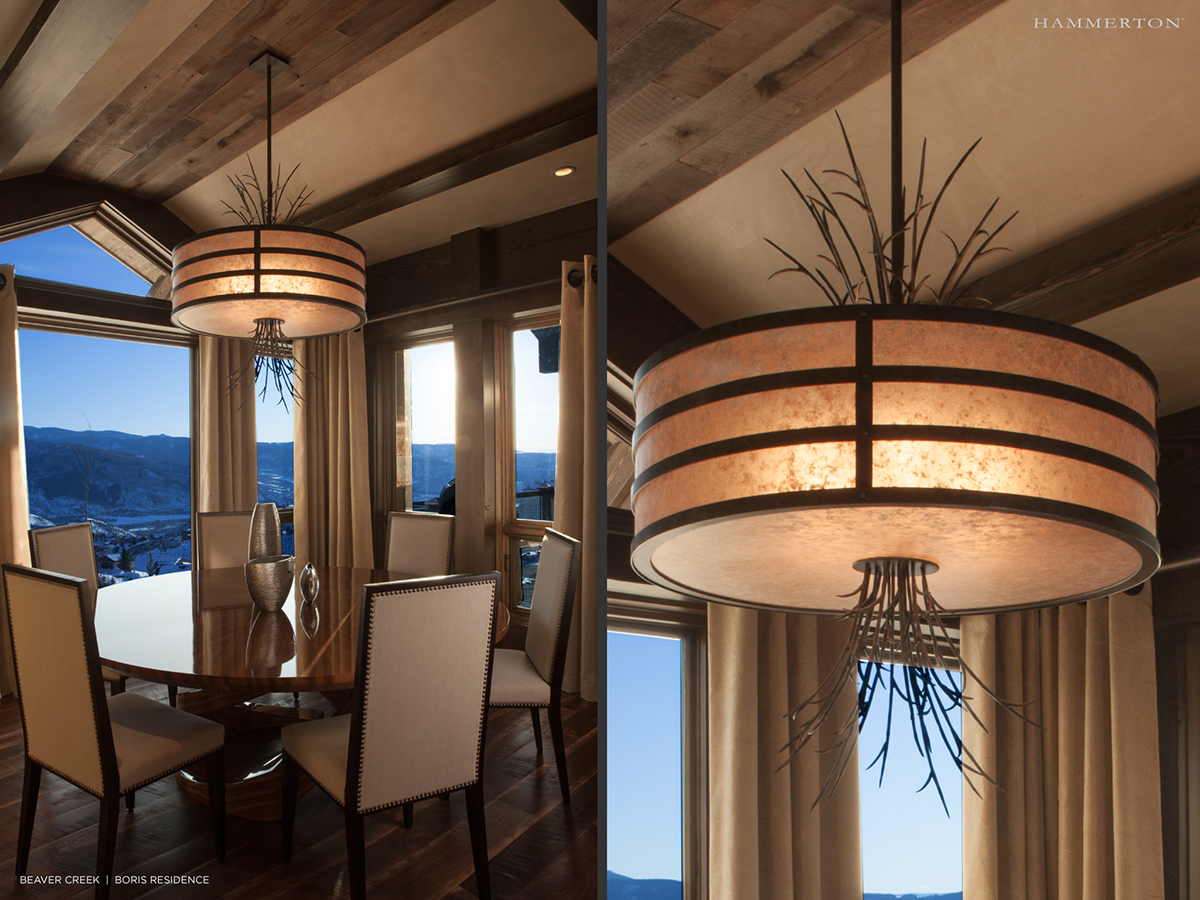 Wisps of grass add an organic element to the CH2299 chandelier seen in this dining room designed by  AP Resort Concepts  | Edwards, CO