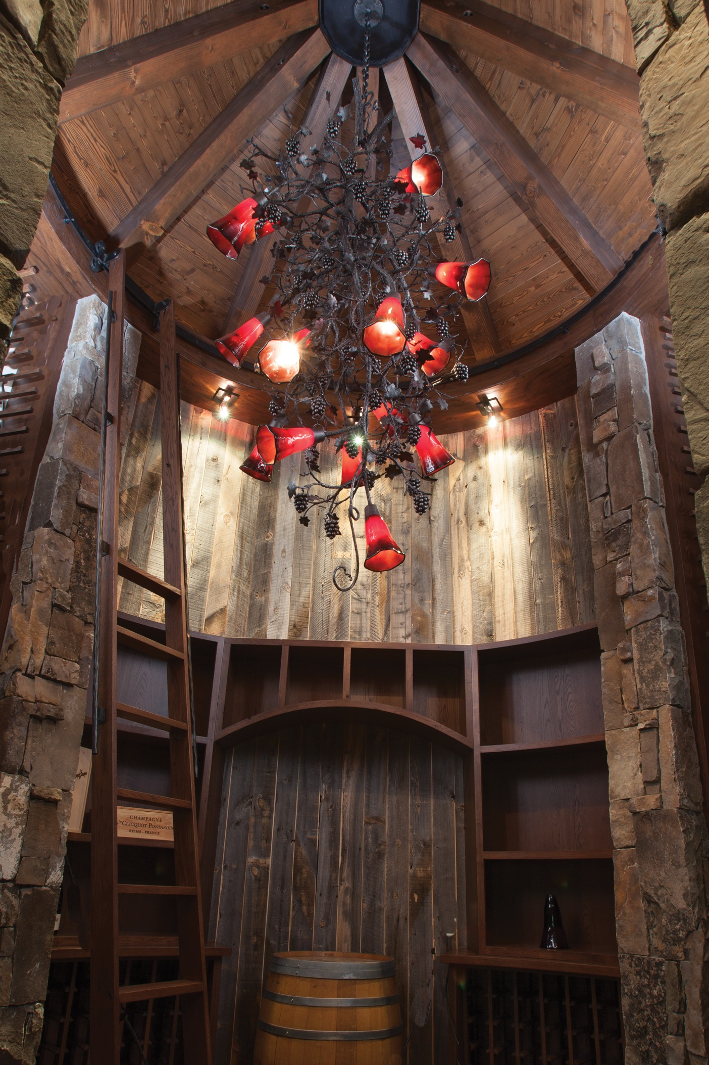 CH7167 chandelier cascades inside a rustic win cellar.