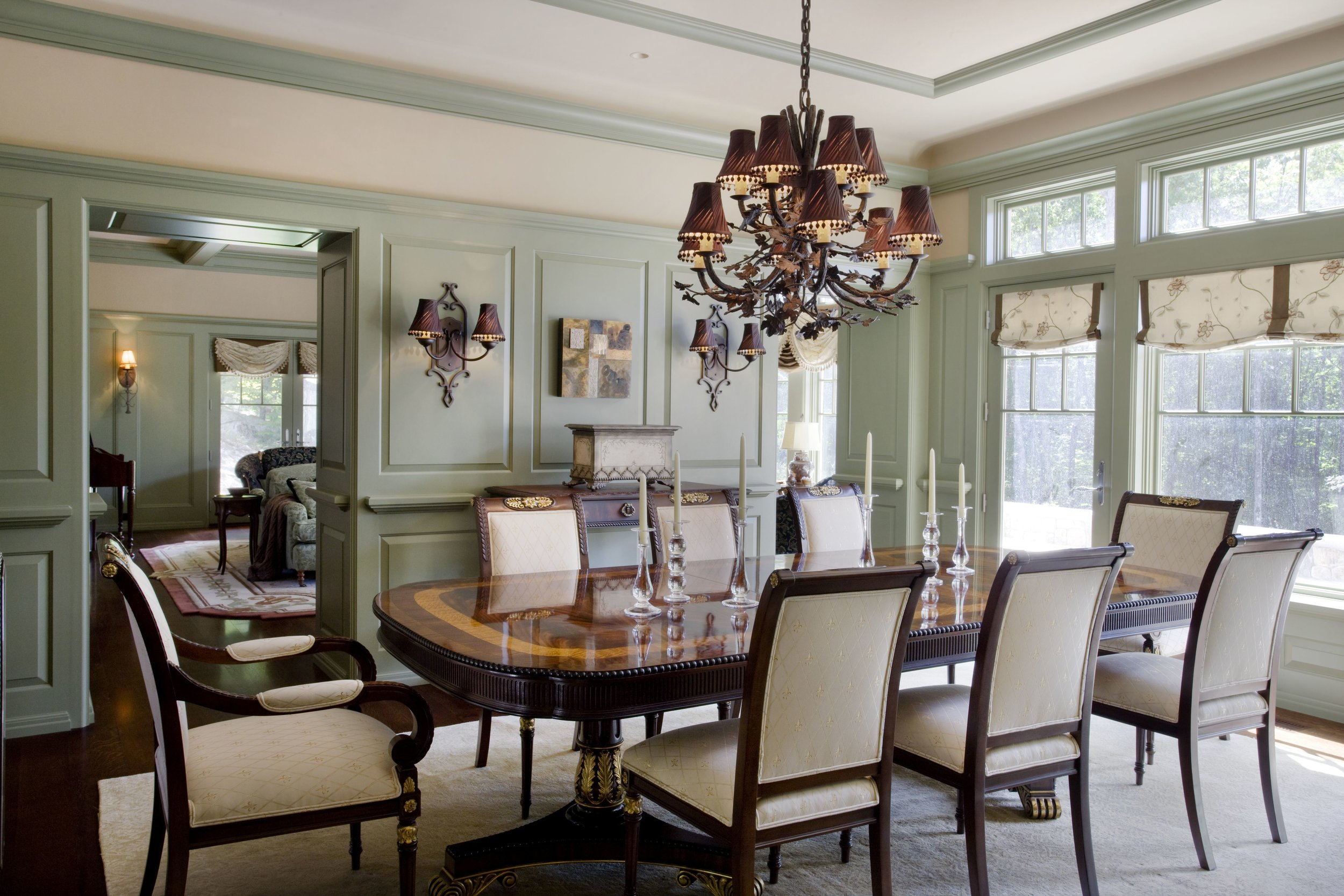 An oak motif Hammerton chandelier in a traditional dining room designed by  Interiors by Randi  | Moultonboro, NH