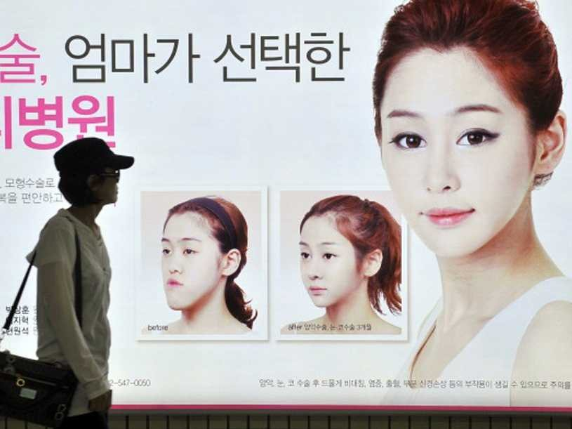 A popular plastic surgery ad that can be seen in most subway s stations showing the results of the popular V-line surgery.