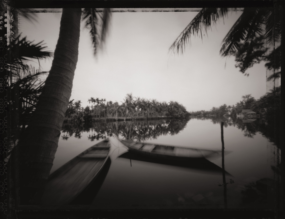 Canoes on the Thu Bon River, Hoi An. UNESCO World Heritage Site.  Pinhole Image © 2007.