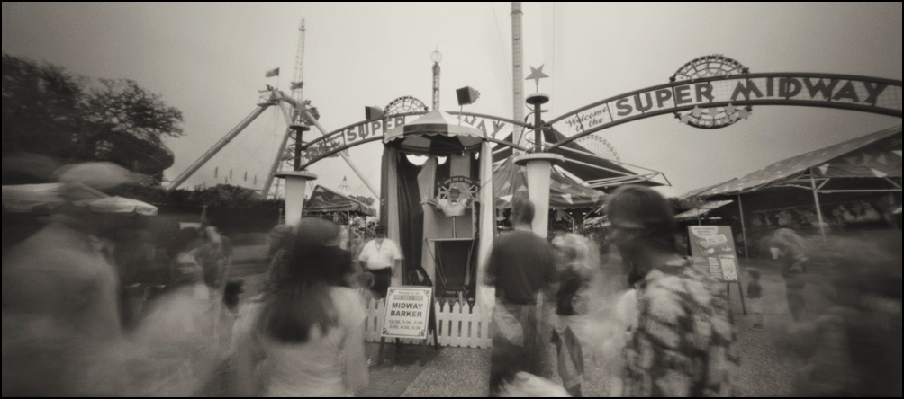Carnival Barker on the Midway . Panoramic Pinhole Image © 2009.