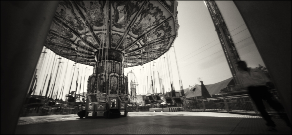Swing Carousel on the Midway. Panoramic Pinhole Image © 2008.