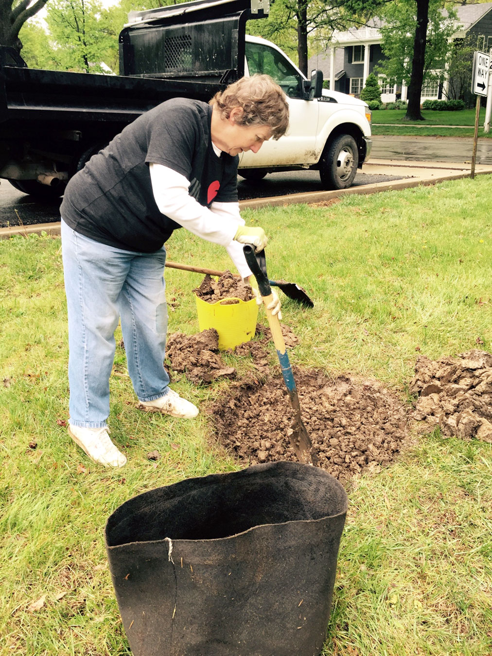 Linda Schroder adds the mulch.