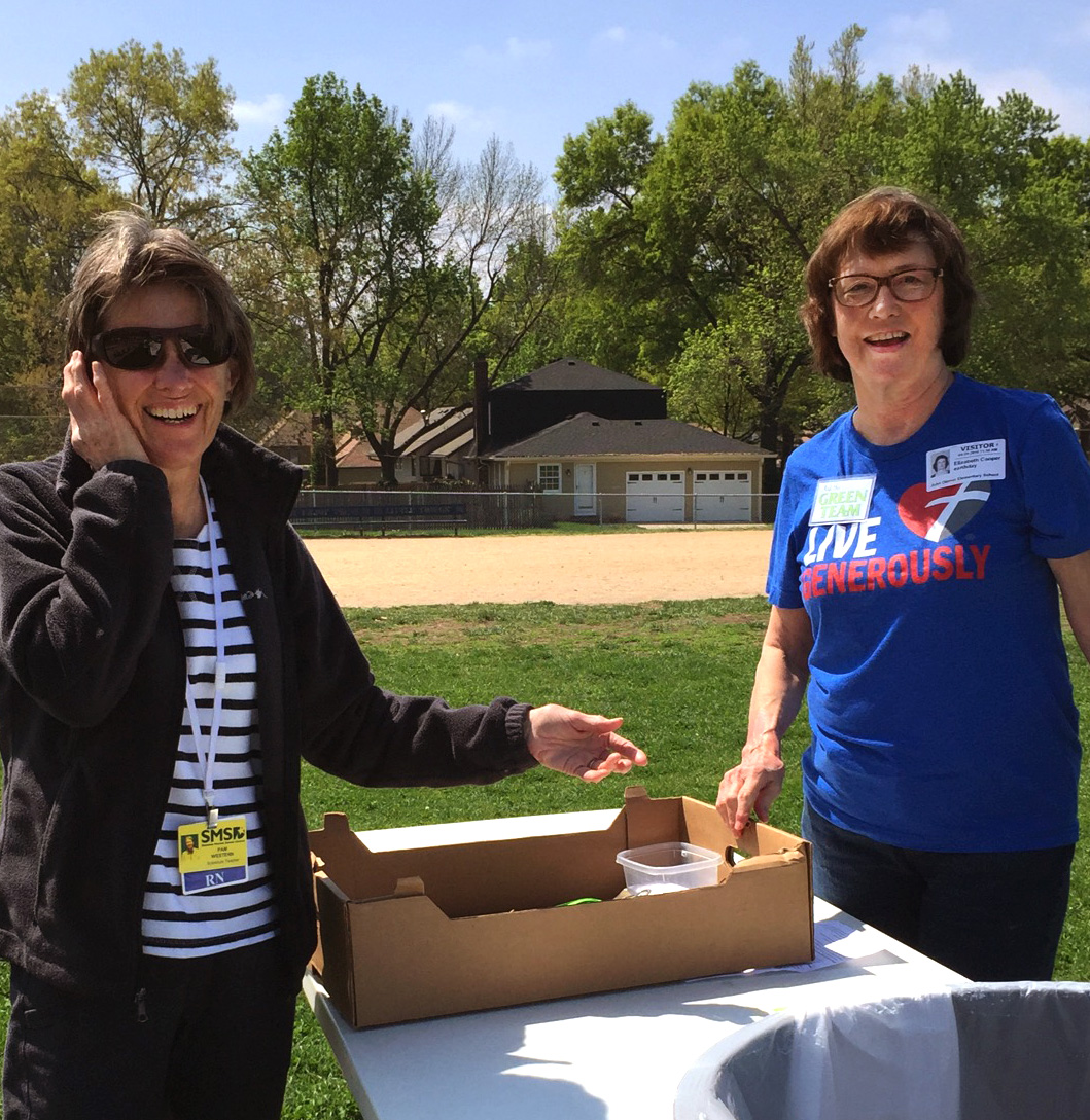 Pam Western and Liz Cooper help the children with packaging.