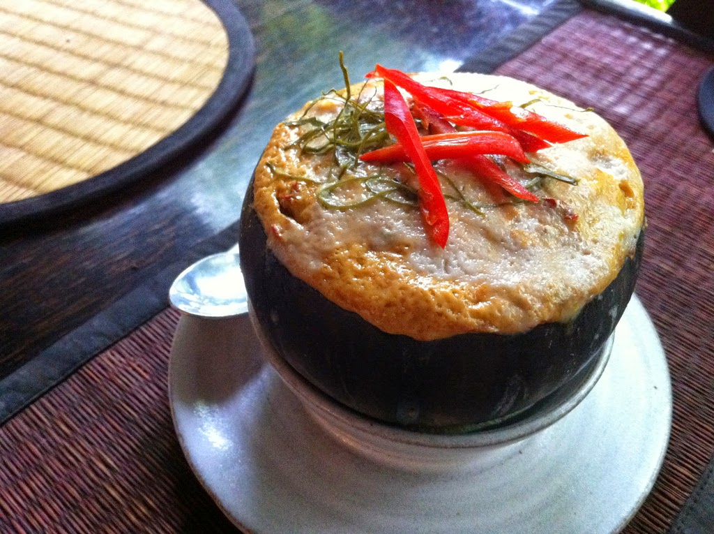 Classic Cambodian Fish Dish with Coconut Cream, served in Coconut Shell