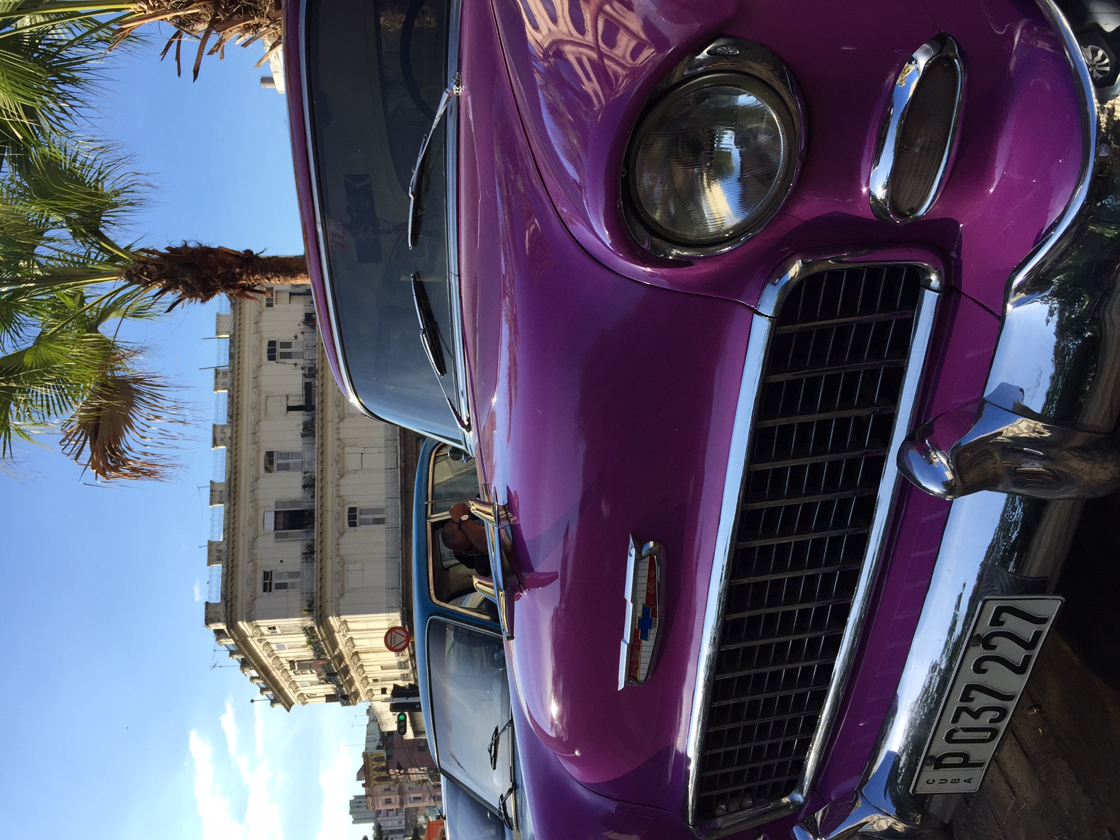 Classic cars parked by La Floridita hotel