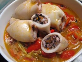 Classic Filipino dish, stuffed squid with heritage rice.  Photo by  Amy Besa
