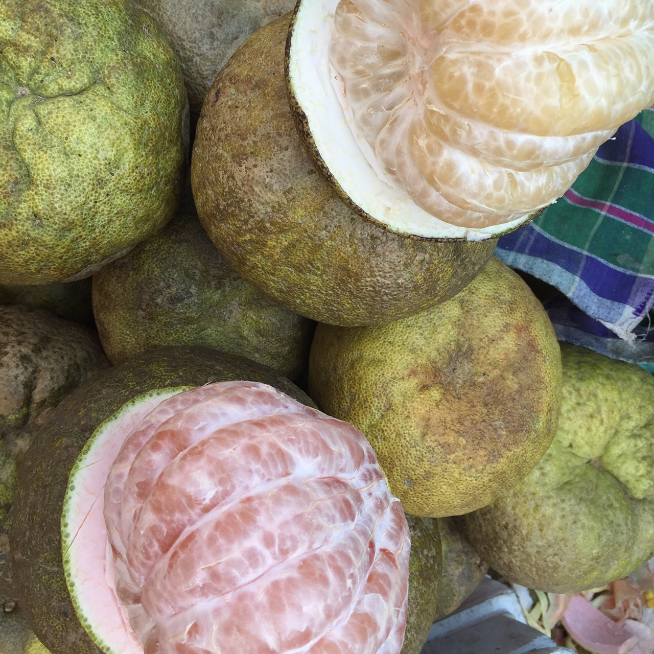 Neatly stacked, basket full of pomelos at the market in Yangon, Myanmar