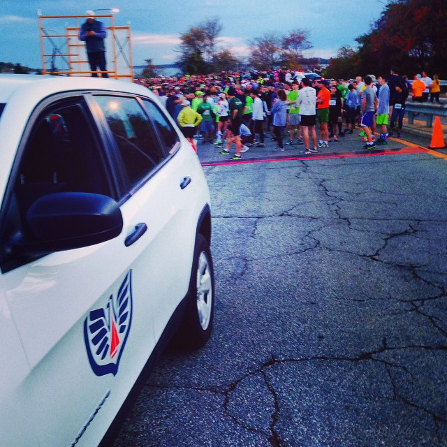 Newport Shipyard pace car at start line of 2014 Pell Bridge Run