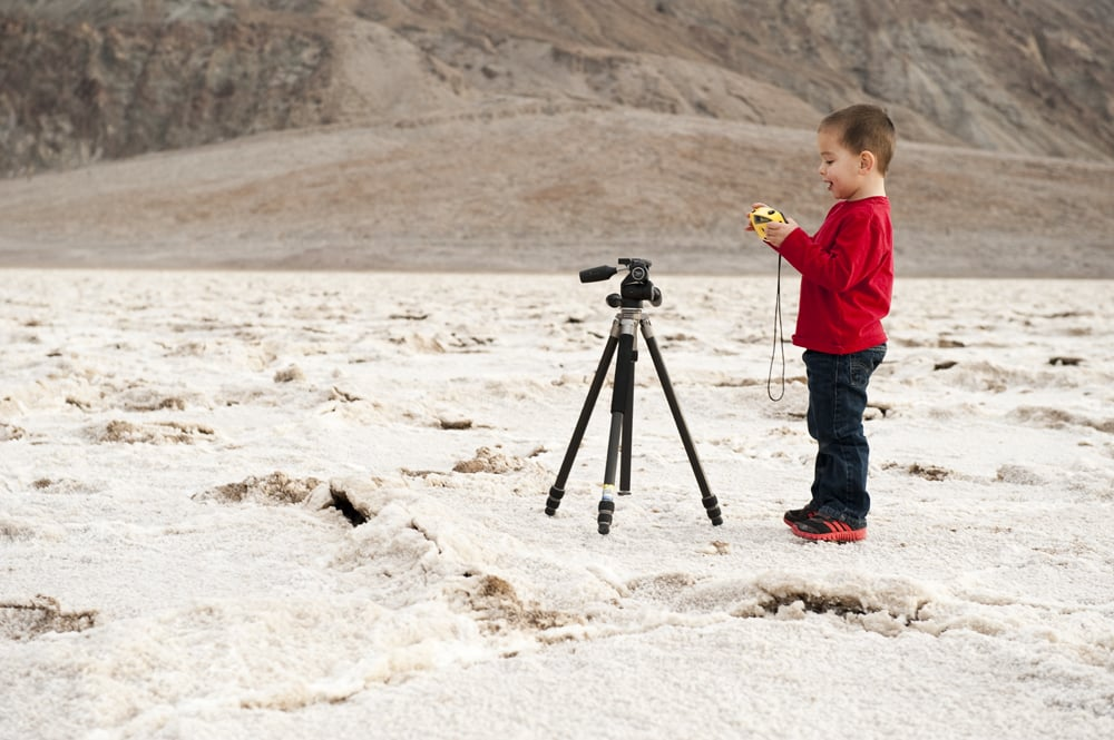 Prepping for the shot. 282' below sea level. Death Valley N.P. 2012. Age 2.