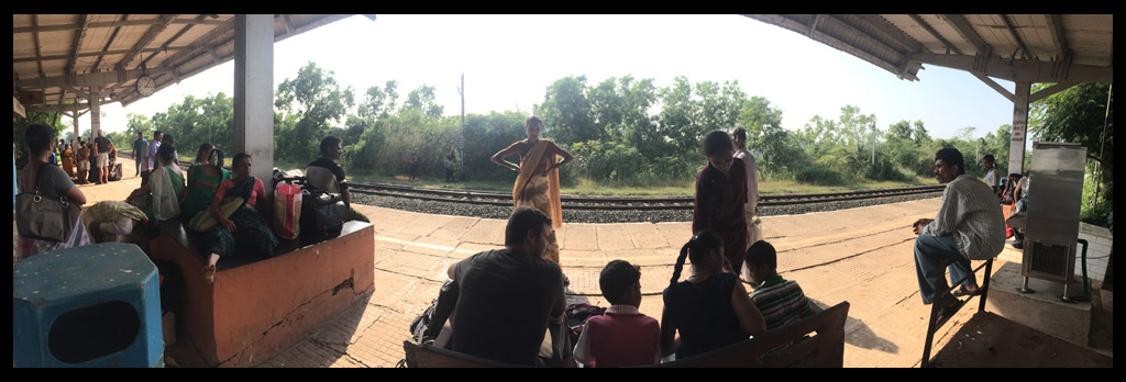 Mikey talking to some very inquisitive children at the Train Station before heading to Gokarna.