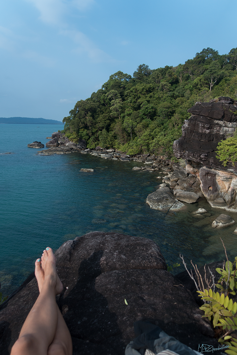 Hanging out on Elephant Rock. You can see the colorful coral down below!