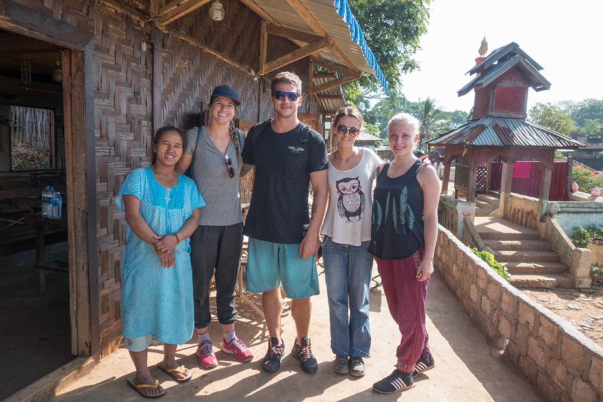 Our trekking group and our host. She was 7 months pregnant and still carrying water from the well, cooking like crazy and picking tea in the fields. What a woman!