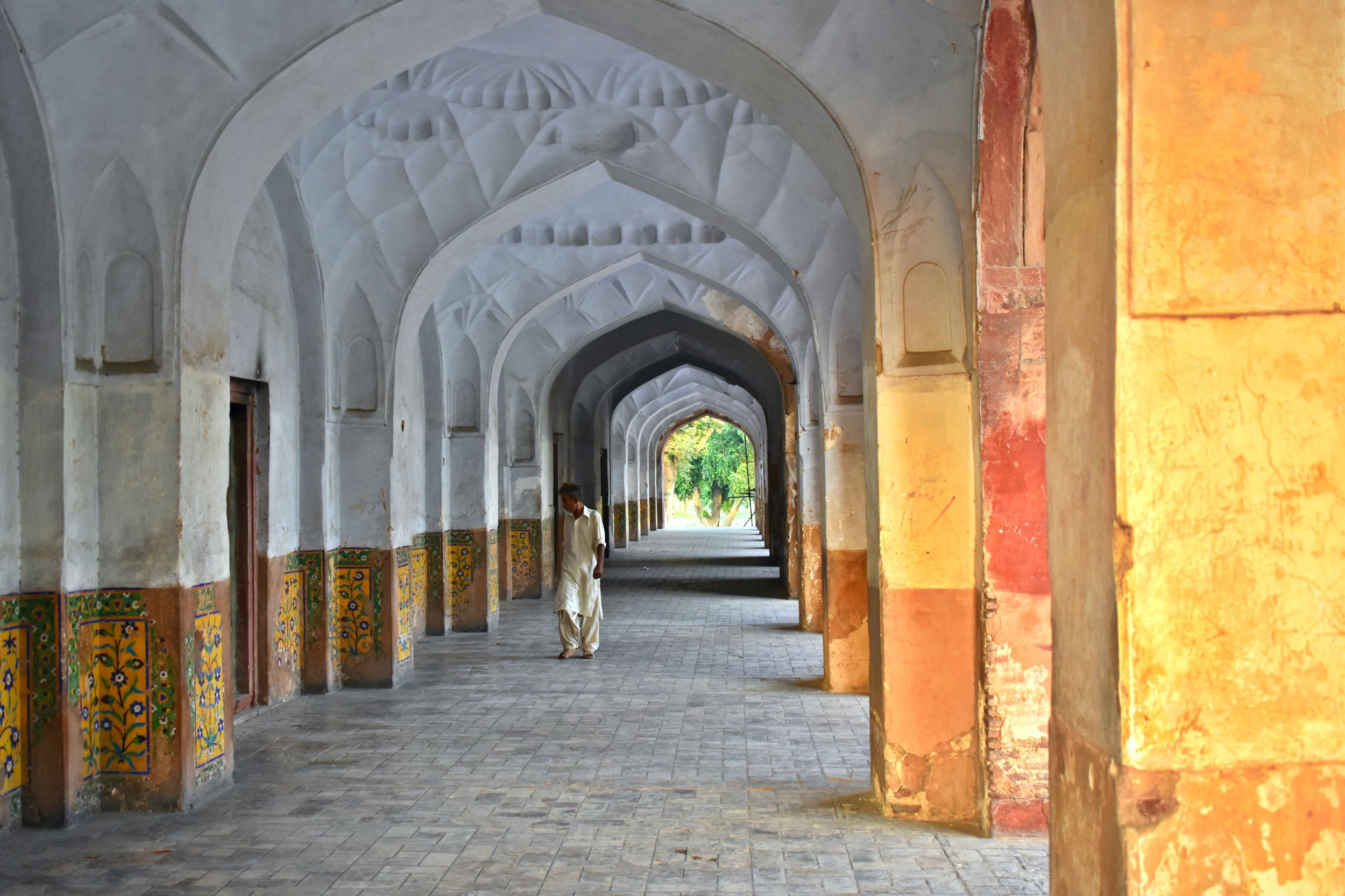 A local wanders through the hallway of Jahangir's Tomb.