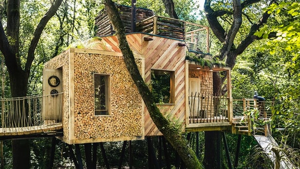 The slide can be seen to the right, there's a hot tub on the roof and access to the Woodsman's Treehouse is gained via an oak door with submarine locking system(Credit:Mallinson)