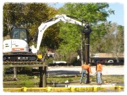 Piling are driven from the deck using a vibratory hammer.