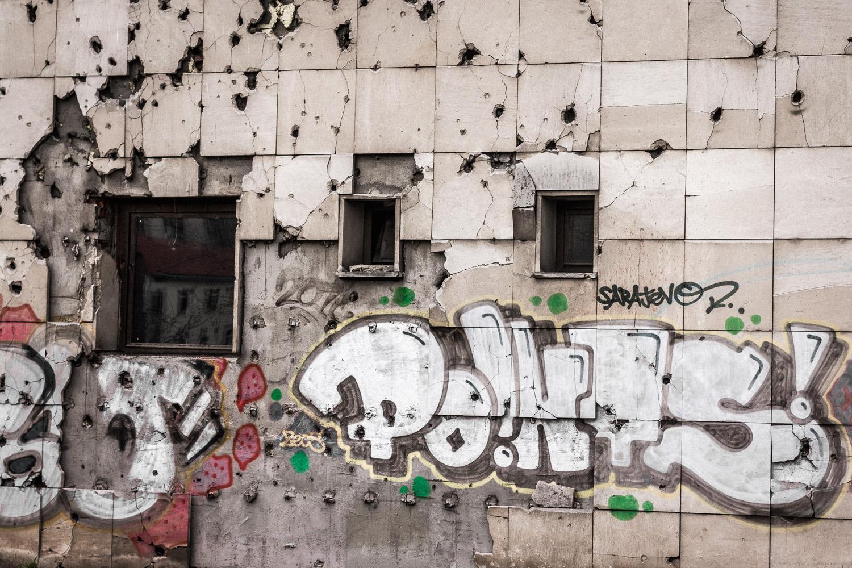 bullet riddled graffiti