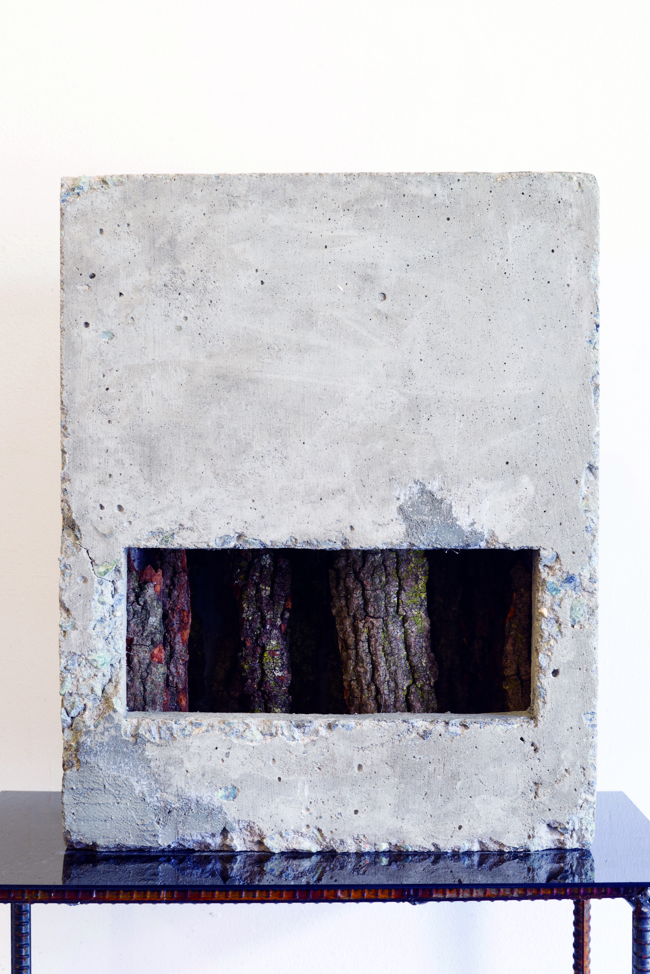 Noa Heyne,  Reenter the Night,  2015. Concrete, tree bark, rebar, and Plexiglass (1 of 3). Dimensions variable.